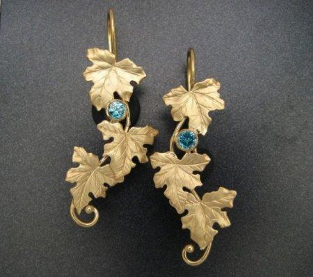 18k maple leaf and zircon earrings