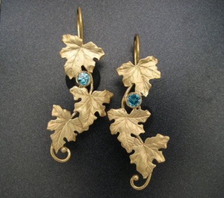 18k maple leaf and zircon earrings