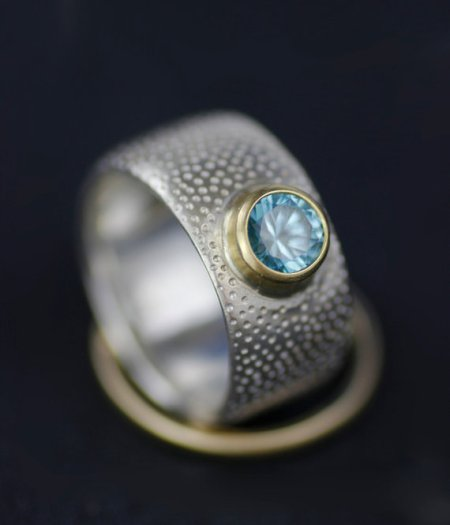 lolide blue zircon and 18k gold engagement ring