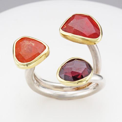 Symmetry rhodolite garnet, spessartite garnet and mandarin garnet 18k gold and sterling silver ring
