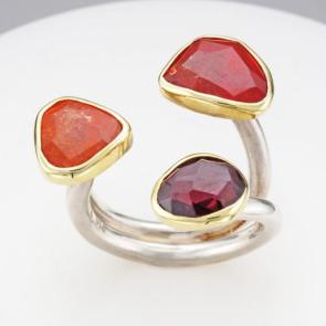 Symmetry rhodolite garnet, spessartite garnet and mandarin garnet 18k gold and sterling silver ring
