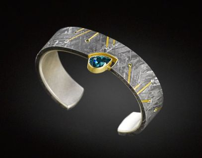 Jacob Albee Cuff bracelet in Gibeon Meteorite with a 3.03 ct blue zircon, 24k gold inlay, diamonds, and a sterling silver sleeve