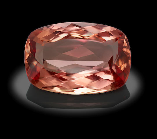 Imperial Topaz, 9.49 carats,15.62 x 10.75 x 6.31mm, Bonhams